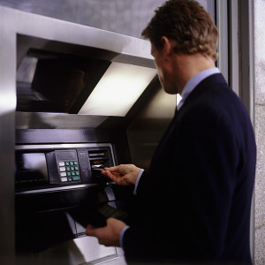 Man putting bankcard into cash machine